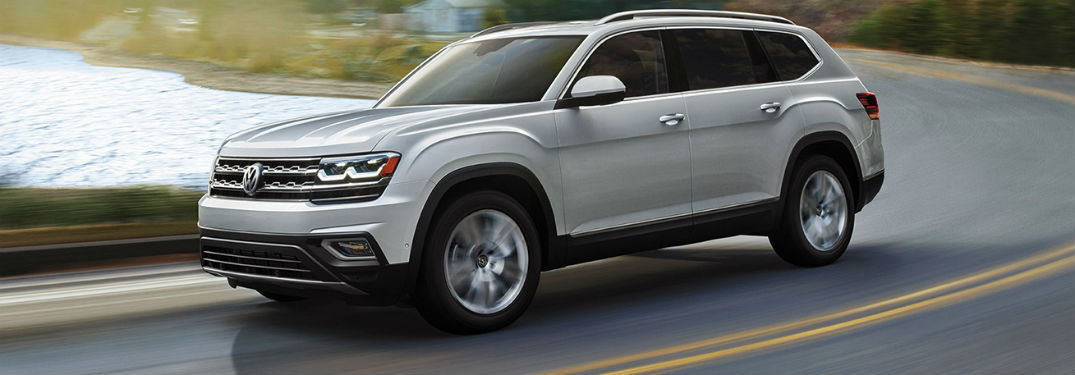 2019 VW Atlas exterior front fascia and drivers side on blurred lake road