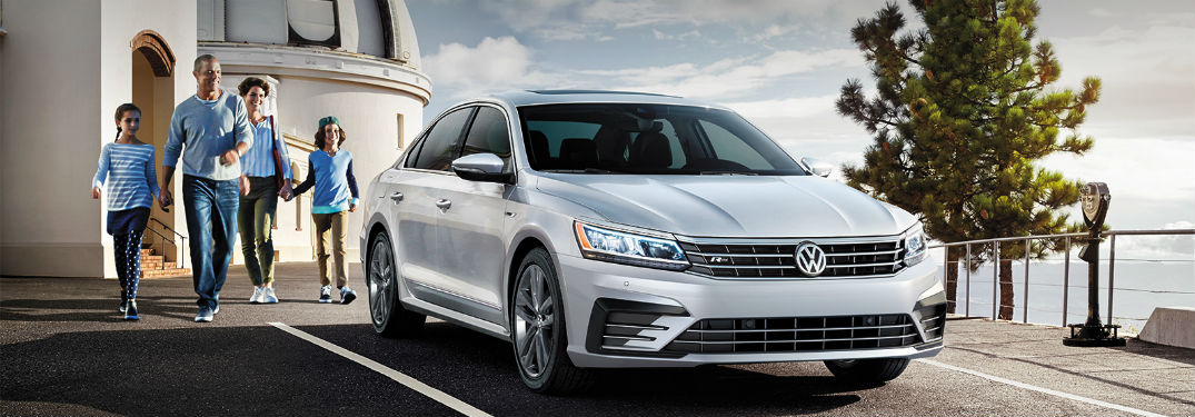 2019 VW Passat exterior front fascia and passenger side with family on left