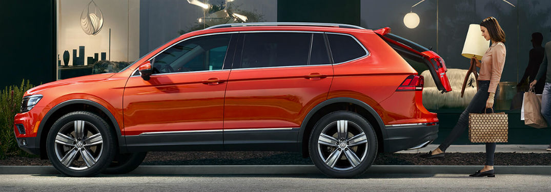 2019 VW Tiguan exterior drivers side profile with woman using automatic trunk function