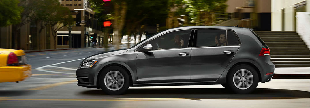 2019 VW Golf exterior driver side profile behind taxi on city road