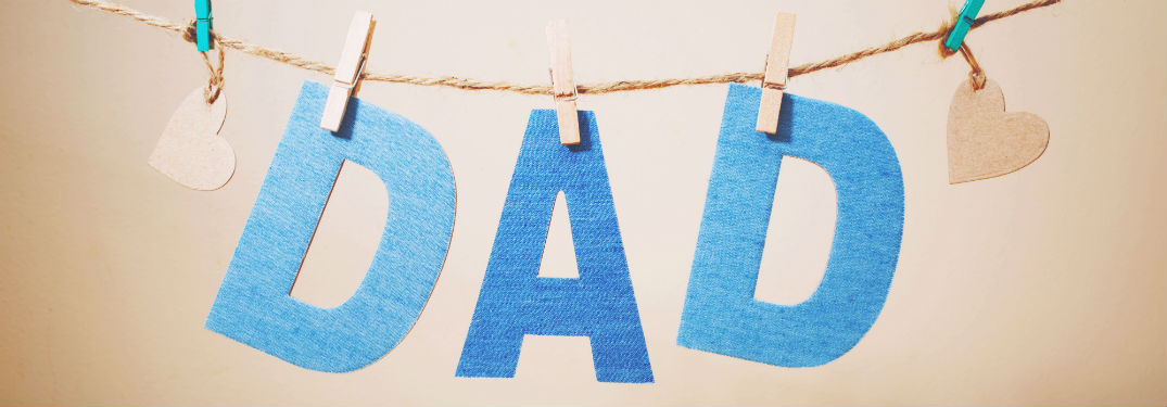 Dad letters hanging on twine held up by clothespin