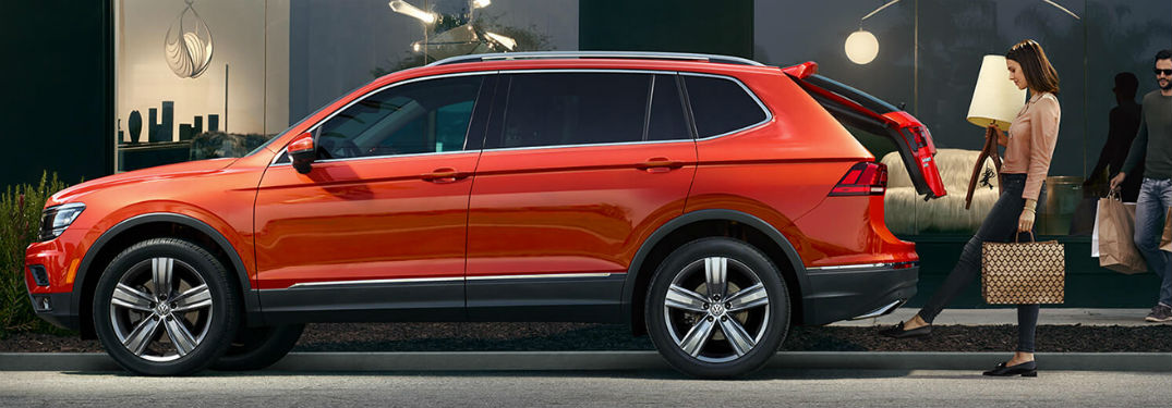 2019 VW Tiguan exterior driver side profile with woman opening trunk