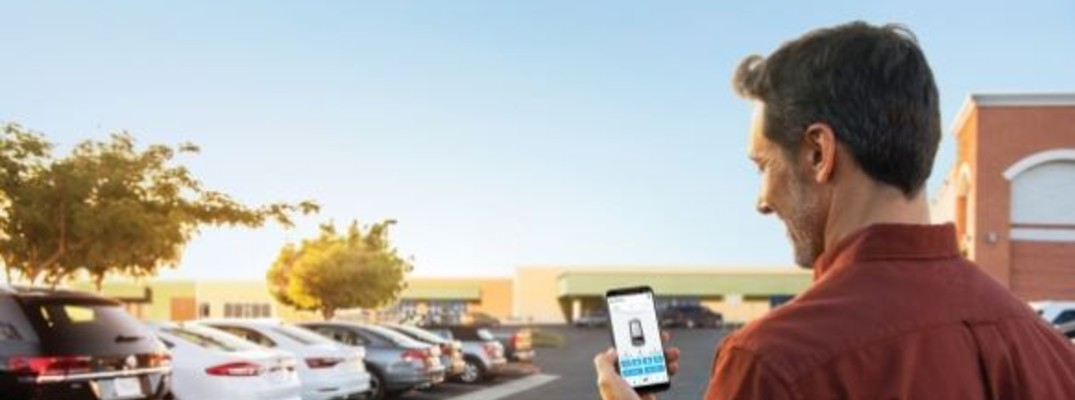 man with phone at a dealership