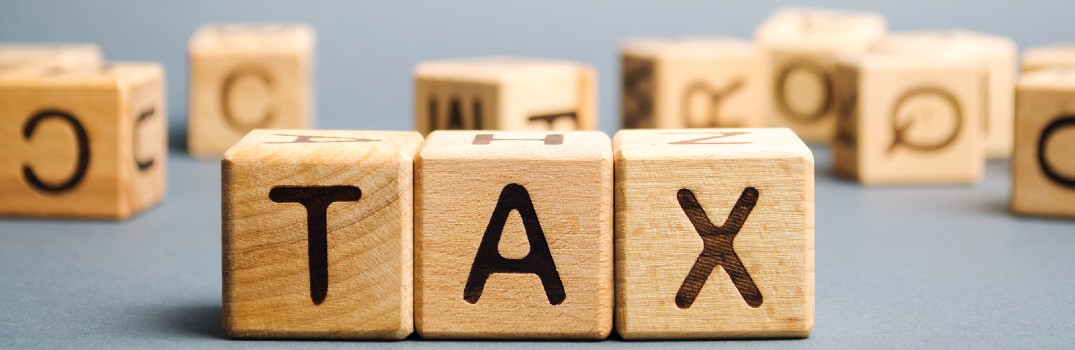blocks spelling out the word 'tax'