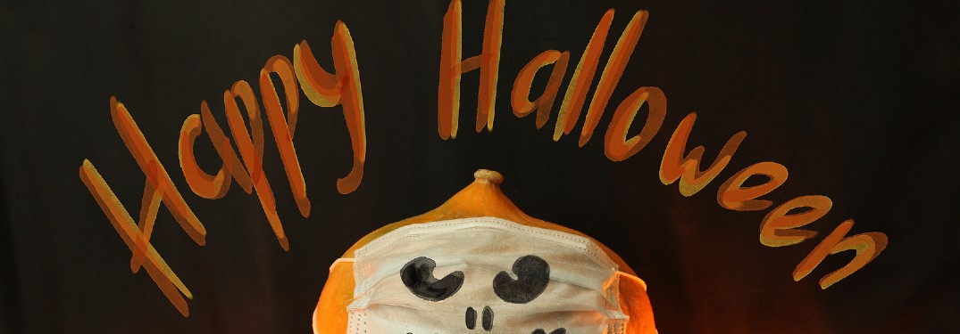 happy halloween with a pumpkin wearing a mask