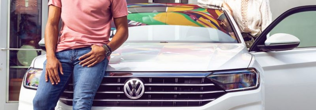 couple in the 2021 VW Jetta