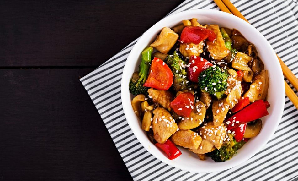 Top view of chicken and vegetable stir fry