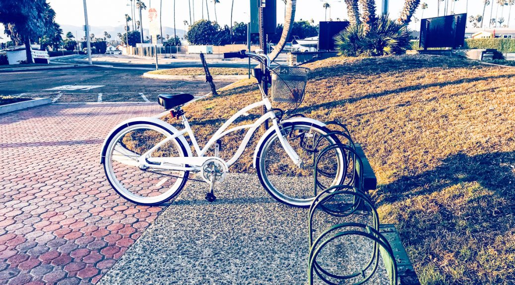 Ventura, California. A bicycle stands in its parking slot.