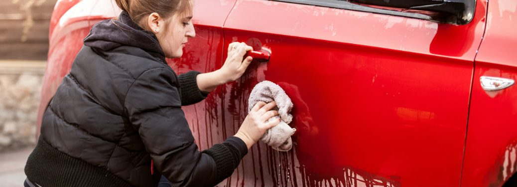 Woman cleaning her vehicle