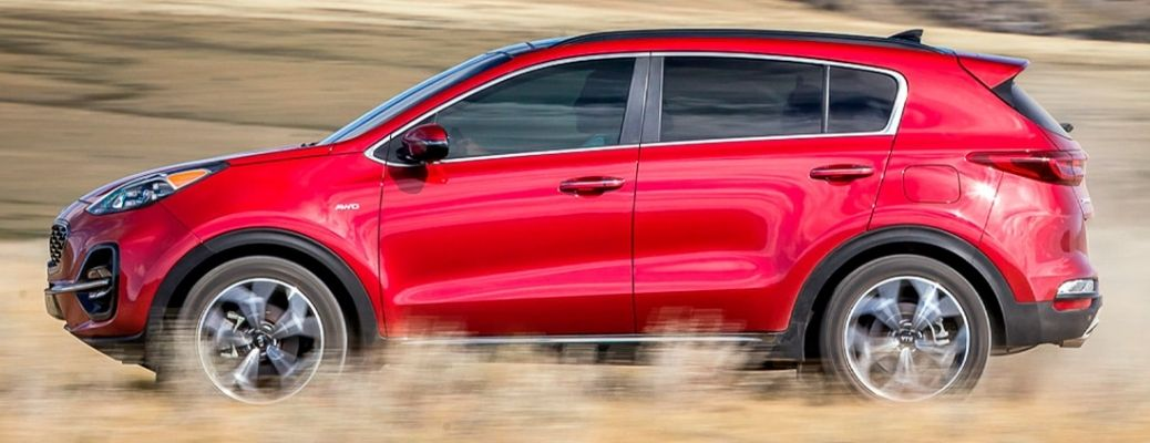 Side view of the 2022 Kia Sportage in red