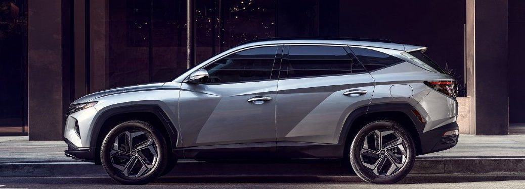 silver 2022 Hyundai Tucson driver side parked on side of street