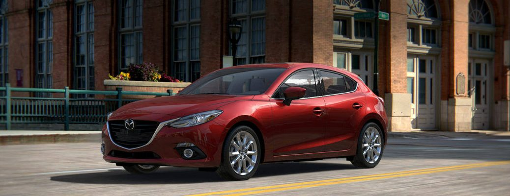 2016 mazda 3 parked on the road