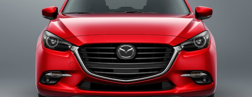 The grille of a red 2017 Mazda3