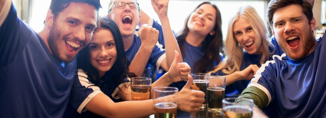 group of people watching sports at a bar