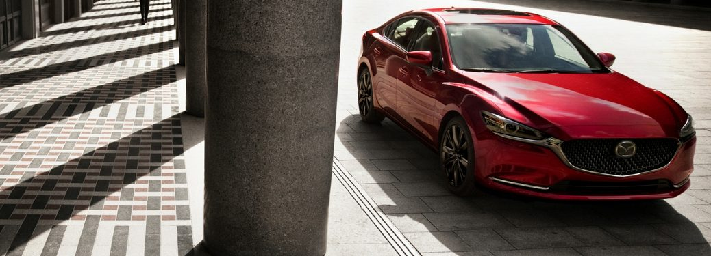 2018 mazda6 in soul red metallic parked