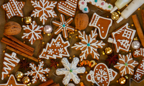 A bunch of cut-out Christmas cookies and cinnamon