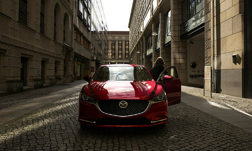2019 Mazda6 exterior front shot with soul red crystal paint color parked on a stone tiled street