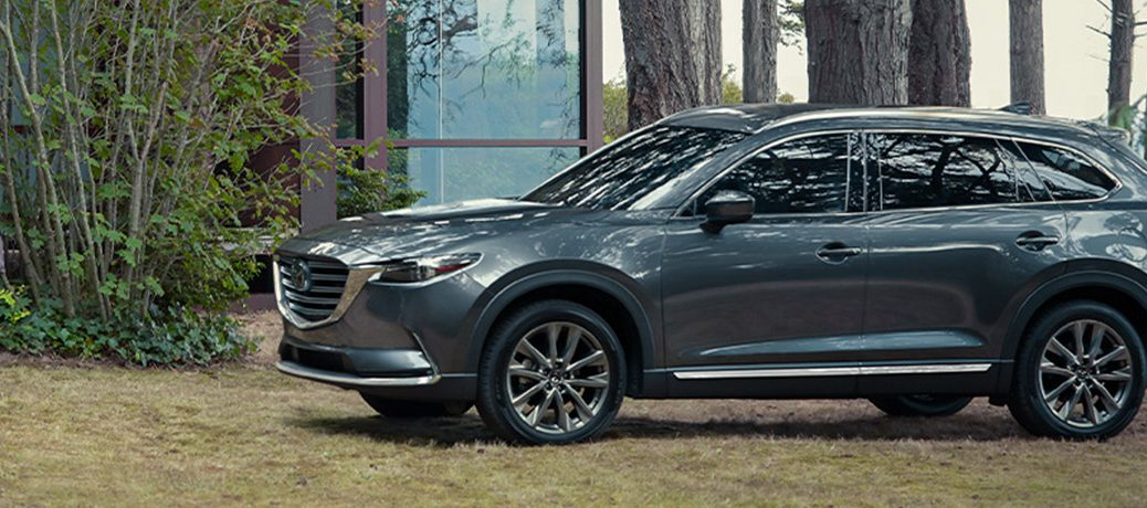 Exterior view of the 2020 Mazda CX-9 parked in the woods