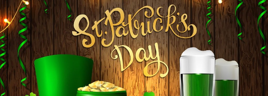 A cartoon banner for St. Patrick's day, filled with a green hat, pot of gold, and green ale.