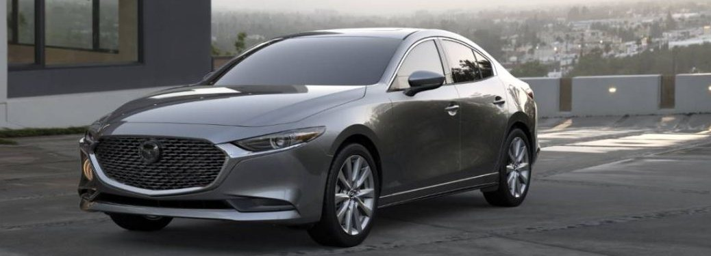 A gray 2020 Mazda3 Sedan parked in a parking lot.