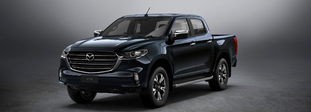 The front and side view of a black 2020 Mazda BT-50 pickup truck/