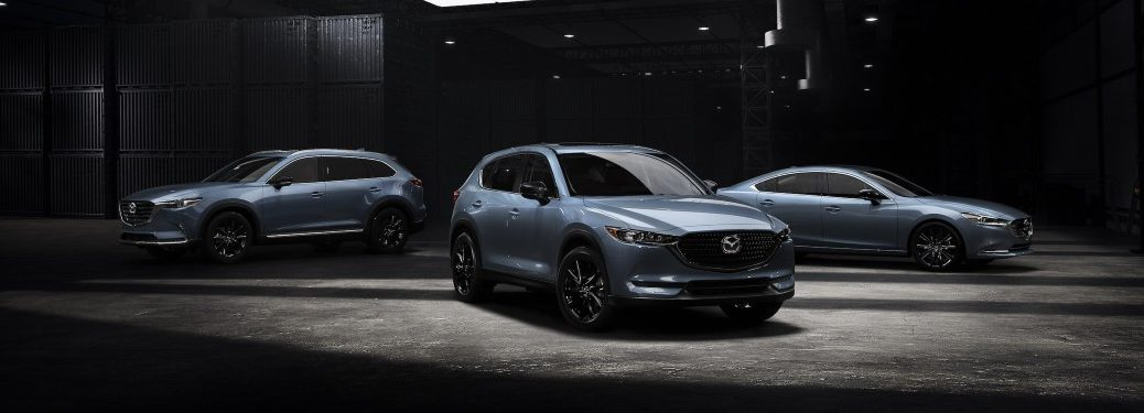 a 2021 Mazda CX-30, CX-5, and CX-5 Carbon Edition trim levels parked on display.