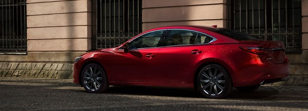 Red 2021 Mazda 6 parked infront a wall