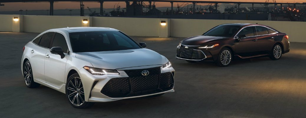 Two 2019 Toyota Avalon Parked Near Each Other in a Parking Lot