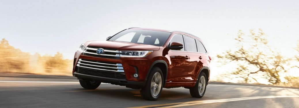2018 Toyota Highlander driving down a highway