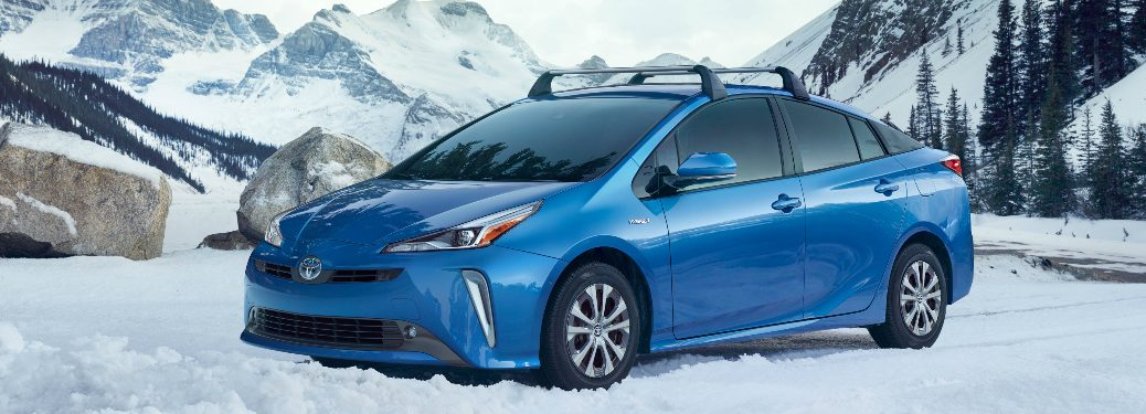 Blue 2019 Toyota Prius parked on a snowy mountain road