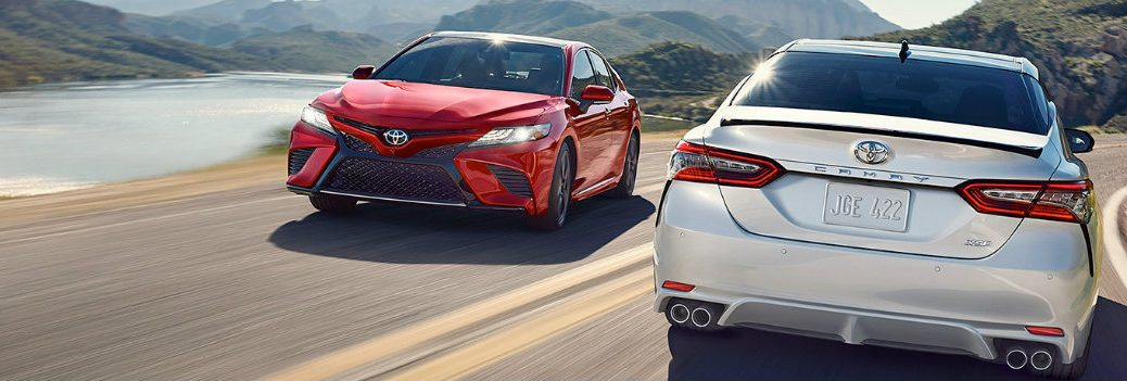 Two 2019 Toyota Camry vehicles passing each other