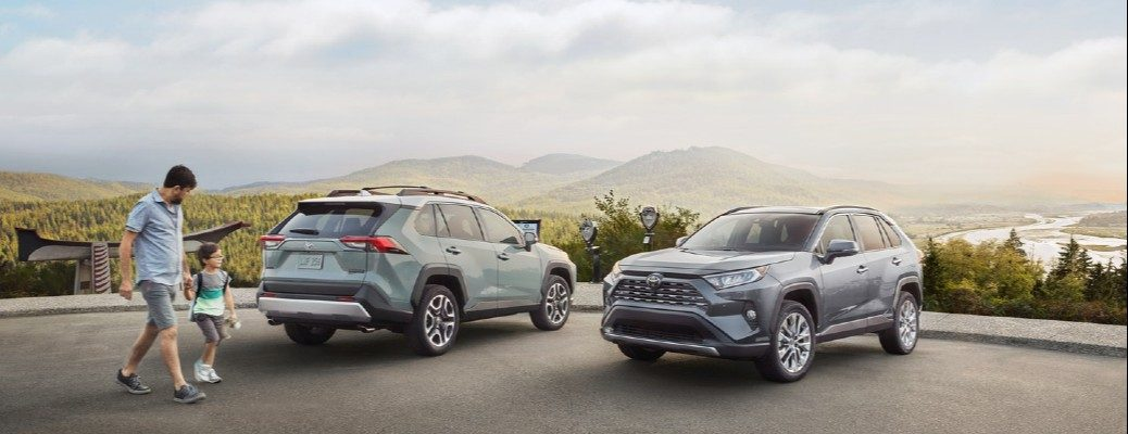 Exterior view of two 2020 Toyota RAV4 models parked next to one another