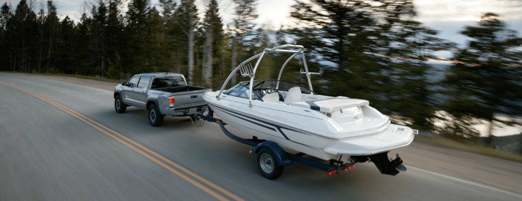 Grey 2020 Toyota Tacoma towing a boat