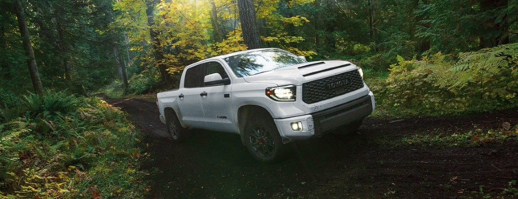 White 2020 Toyota Tundra driving through a forest