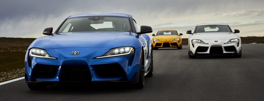 Blue, yellow, and white versions of the 2021 Toyota GR Supra