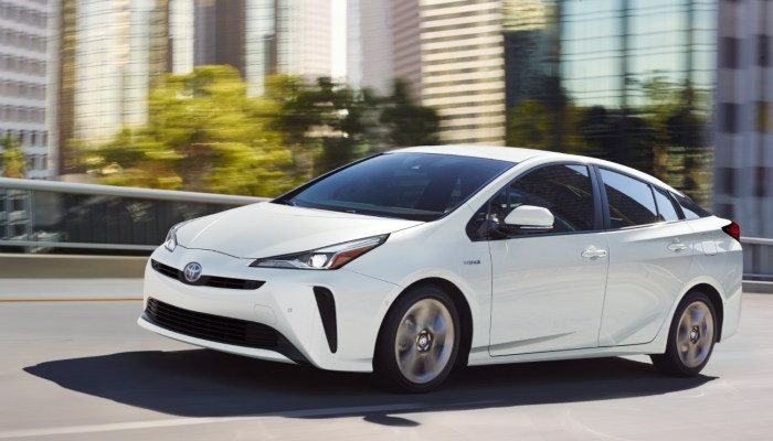 2021 Toyota Prius driving down a city street