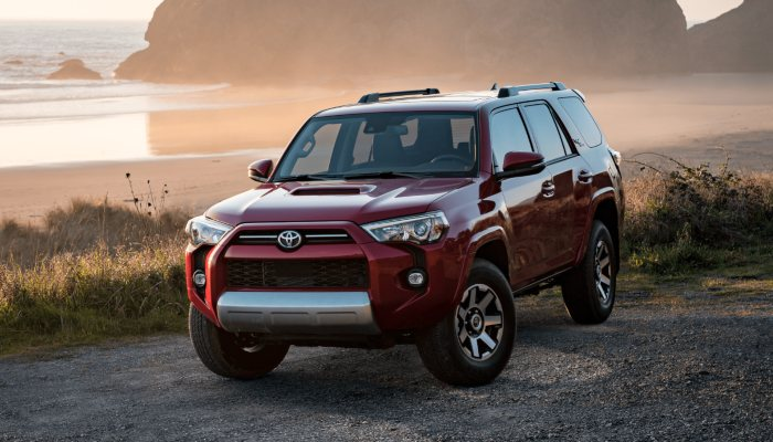 2021 Toyota 4Runner parked on a road near a beach