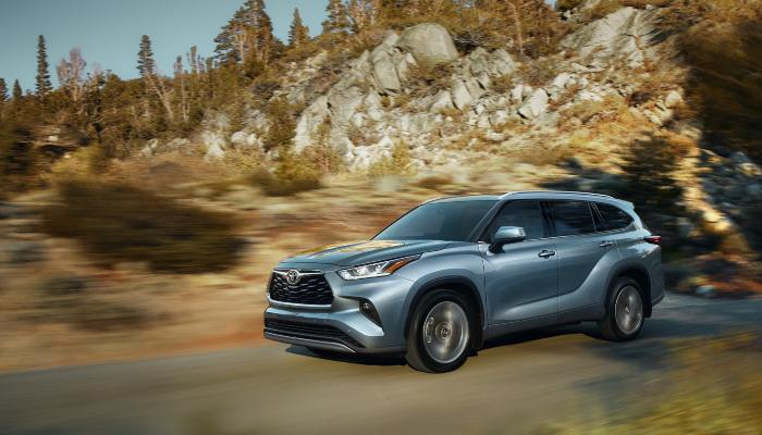 2021 Toyota Highlander driving down a rural road
