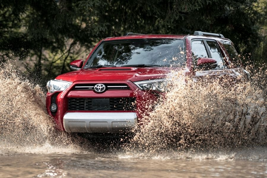 2021 Toyota 4Runner Front Left-Quarter View Wading Through a Muddy Puddle.