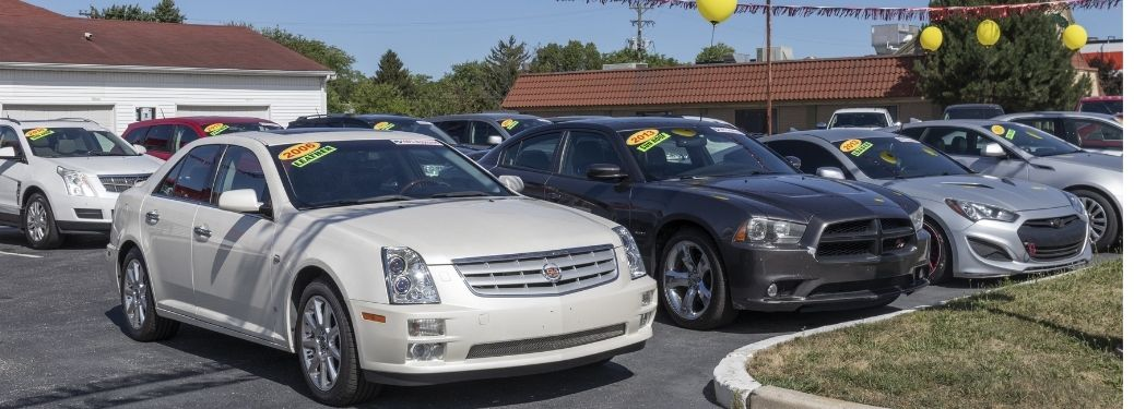 cars line up in a used cars showroom