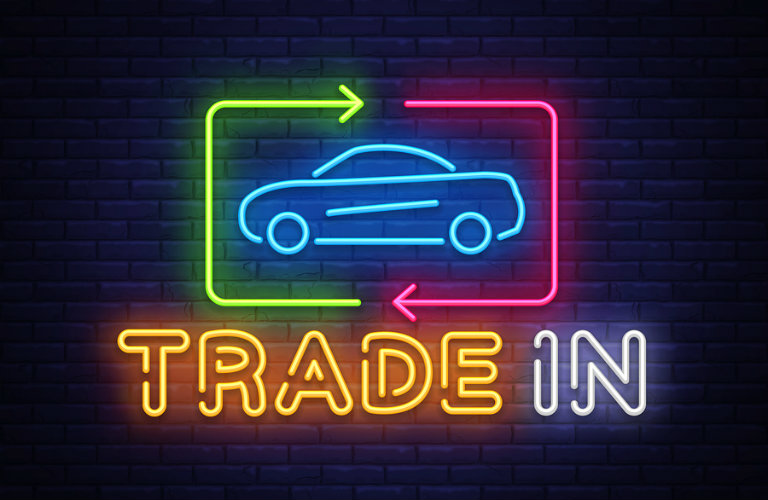 Neon sign highlighting trading in a car