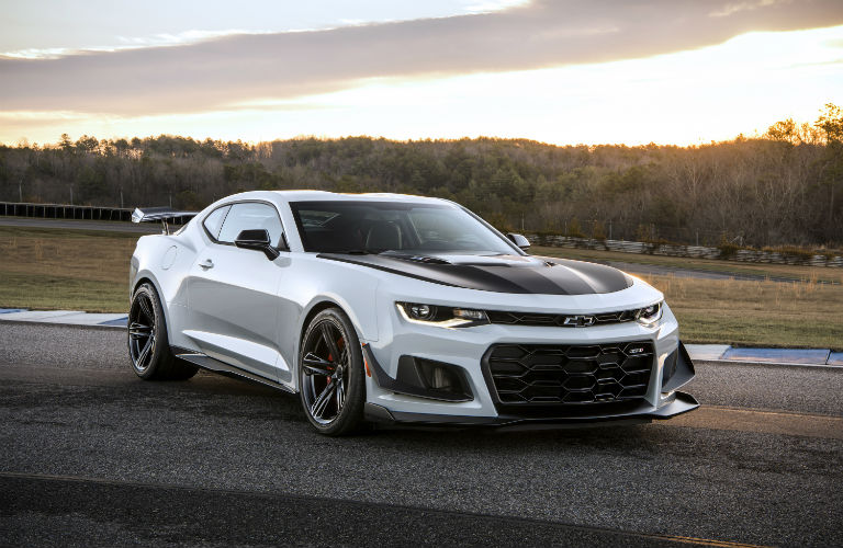 Exterior view of a silver 2018 Chevrolet Camaro ZL1 parked on an empty race track