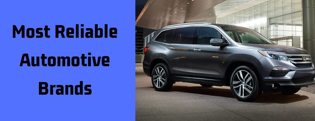 "Exterior view of a gray 2017 Honda Pilot with ""Most Reliable Automotive Brands"" in black text against a blue background to the left of vehicle"