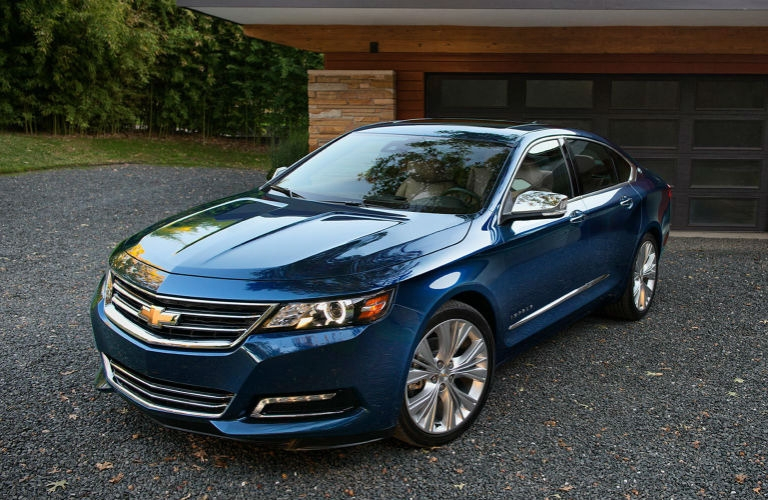 Exterior view of a blue 2017 Chevrolet Impala parked in a driveway