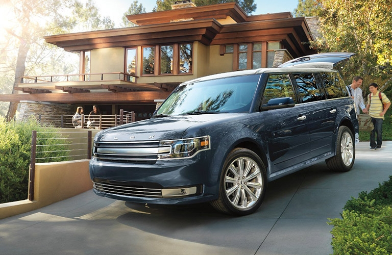 Exterior view of a blue 2017 Ford Flex parked in a driveway
