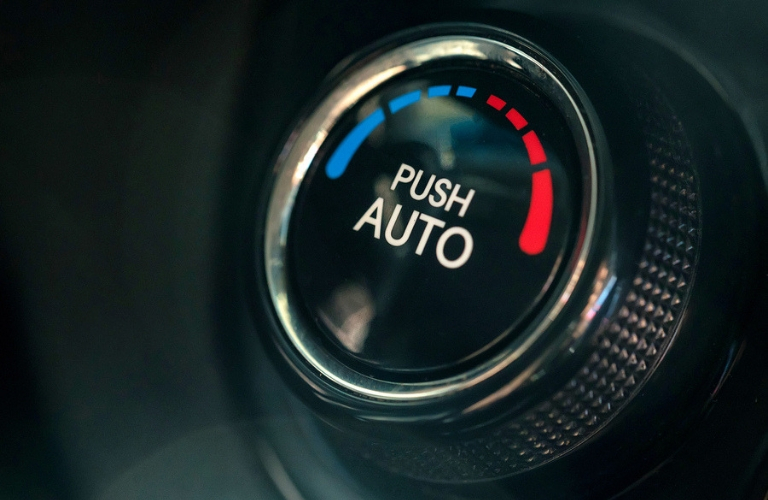 Closeup view of an automatic climate control knob inside a vehicle