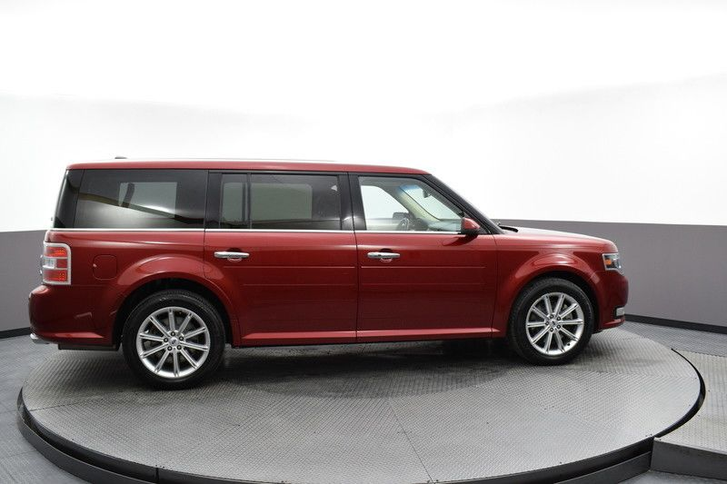Passenger's side view of the red 2017 Ford Flex Limited AWD