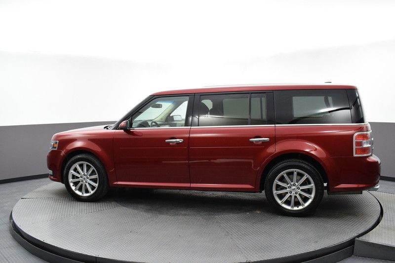 Driver's side view of the red 2017 Ford Flex Limited AWD