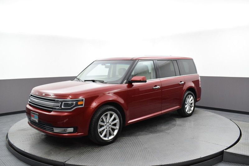 Front driver's side view of the red 2017 Ford Flex Limited AWD