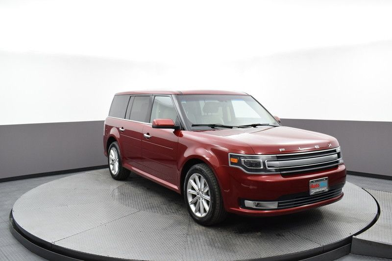 Front passenger's side view of the red 2017 Ford Flex Limited AWD